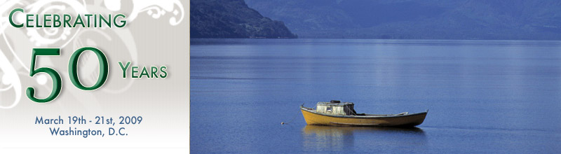 Celebrating 50 years, 3/19-3/21, 2009. A lone boat drifting in a vivid blue lake